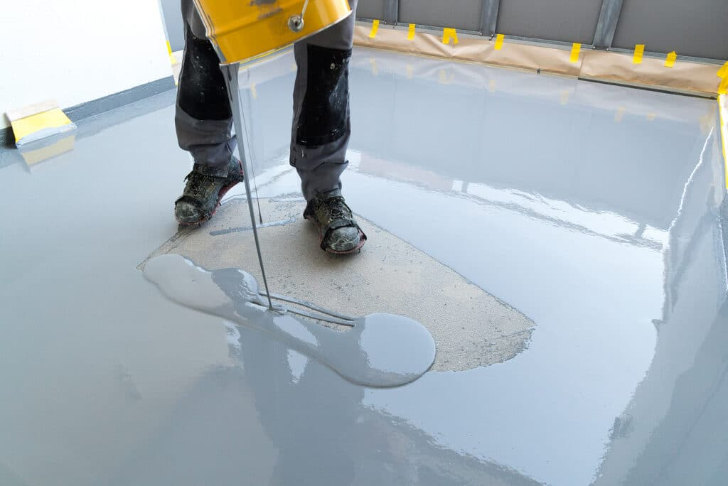 Construction worker pouring resin